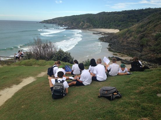 HSIE Students sitting on top of a local hill